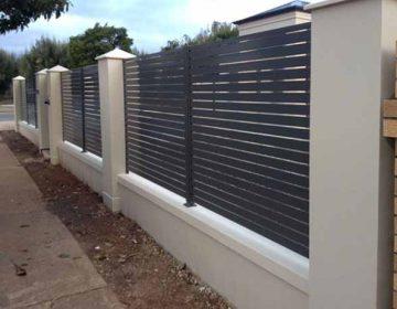 Pillars with aluminium slat fence
